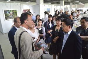 Exposition photographique avec les photographies de Jean-Yves Bardin sur les portraits de vignerons à Yantai en Chine aux Gourmand Awards International